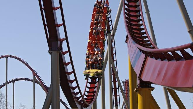 Guests ride on the Diamondback roller coaster at Kings Island Amusement Park in Mason, Ohio.