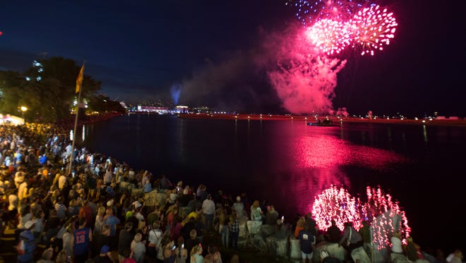 Crowds watch the Big Bang Fireworks at Summerfest on opening night of the 2016 festival.