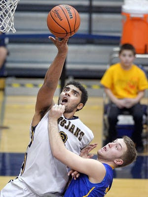 Greece Athena's Anthony Lamb, left, reaches for a rebound over Irondequoit's Mitch Senecal during a Class A1 sectional semifinal game played at Gates Chili High School on Tuesday, February 23, 2016. #1 seed Greece Athena advances to the final with a 71-65 overtime win over #4 seed Irondequoit.