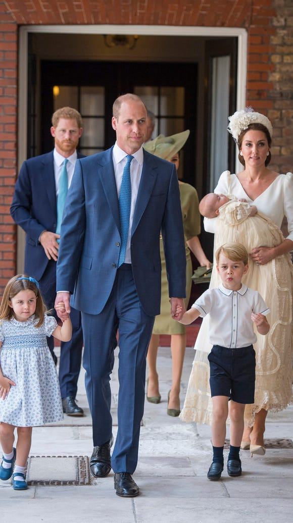 Prince Wiliam leads Princess Charlotte and Prince George