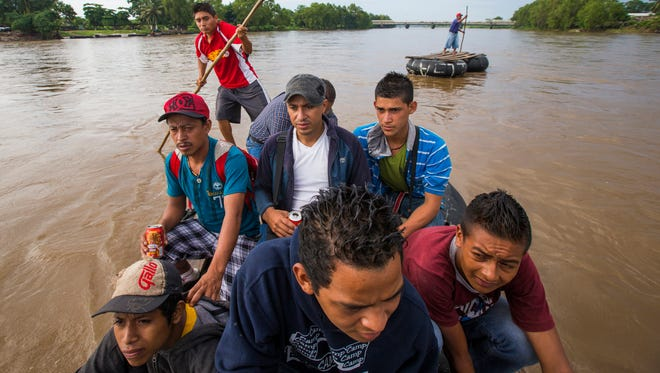 Migrants from Central America illegally cross into Mexico from Guatemala using a raft on the Suchiate River June 22, 2014. They were all headed for the U.S. but weren't sure which route they were going to take through Mexico. Crime and lack of jobs have sent people from Central America to the U.S. in increasing numbers. Minors on this raft include Jairo Garniga, 16, from Guatemala (front left) and Julio Carcam, 20 from San Salvador (front center) and Antoni Castellan, 17 from Honduras (front right).