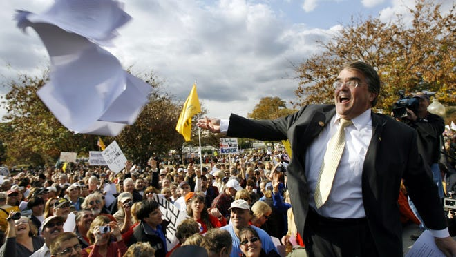 Rep. John Culberson, R-Texas, throws the health care bill to the crowd on Capitol Hill in November 2009.