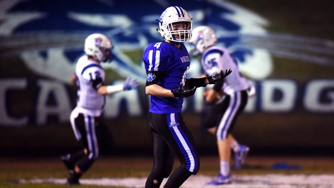 Cambridge's Bryce Antill looks toward his teammates in disbelief after Zanesville's Robbie Bruce caught an 80-yard touchdown pass just before halftime of the Blue Devils' 24-20 win on Friday night at McFarland Stadium. The score gave ZHS a 17-14 lead.