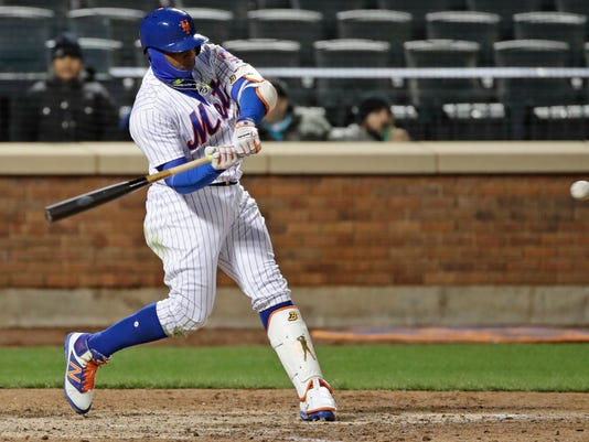 New York Mets' Yoenis Cespedes starts his swing on a home run during the eighth inning of a baseball game against the Miami Marlins on Friday, April 7, 2017, in New York. (AP Photo/Frank Franklin II)