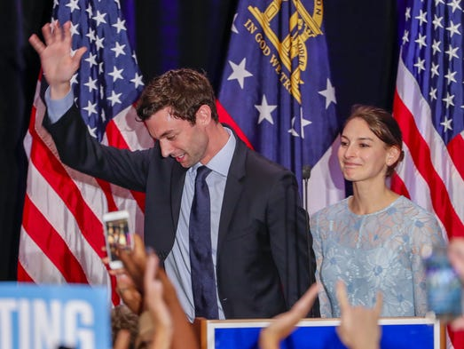 Jon Ossoff waves next to his fiance Alisha Kramer