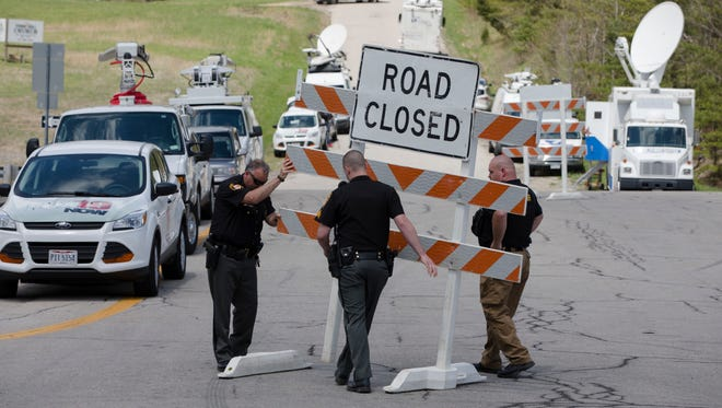 Authorities set up road blocks at the intersection of Union Hill Road and Route 32 at the perimeter of a crime scene, on April 22, 2016, in Pike County, Ohio.