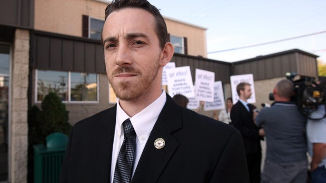 Seen in this 2010 file photo, then-Union County Humane Society Executive Director Steffen Baldwin faces a 42-count felony indictment which includes charges of cruelty to companion animals, grand theft, bribery, telecommunications fraud, tampering with evidence and impersonating a peace officer. The charges related to the deaths of at least 18 dogs.