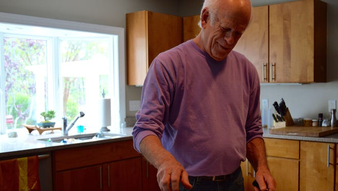 Jonathan Spivak prepares a salad for lunch in his home.