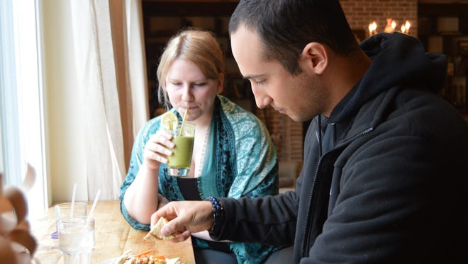 Rachael Long and Dan Reshef enjoy lunch at Nectar Cafe and Juice Bar.