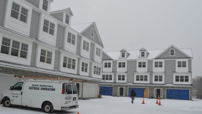 Rye Brook issued a stop-work order on the 10-unit project on Bowman Avenue after Kip Konigsberg's company failed to pay property taxes on an adjacent parcel that was to be given to the village. That parcel was taken by tax foreclosure by Rye town.