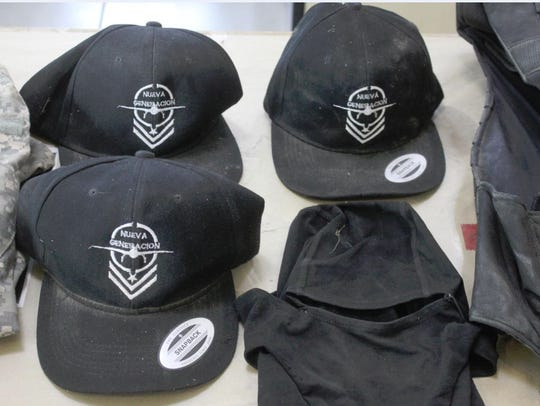 Caps with a Nueva Generacion logo were found along