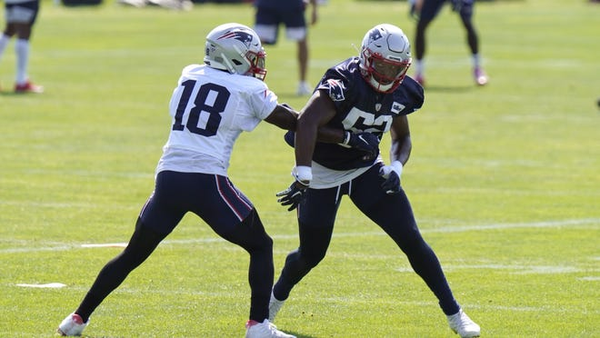 New England Patriots wide receiver Matthew Slater (18) and linebacker Brandon Copeland (52), right, perform field drills during a training camp practice, Sunday, Aug. 23, 2020, in Foxboro.
