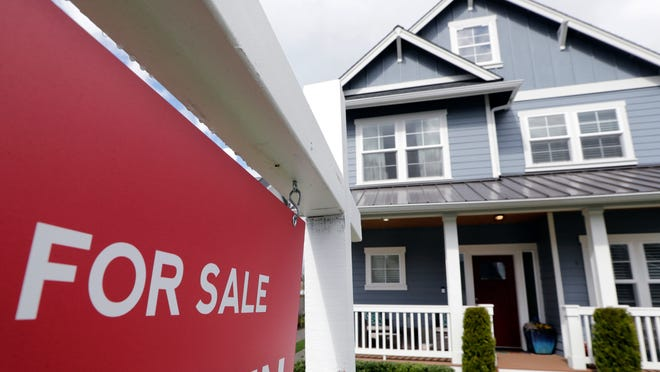 "FILE - In this April 1, 2020 photo, a ""For Sale"" sign stands in front of a home The economic shutdown of March and April stalled it, but the spring real estate season eventually reached full bloom amid ""super strong"" demand that drove prices up to new highs, data on home sales in July shows."