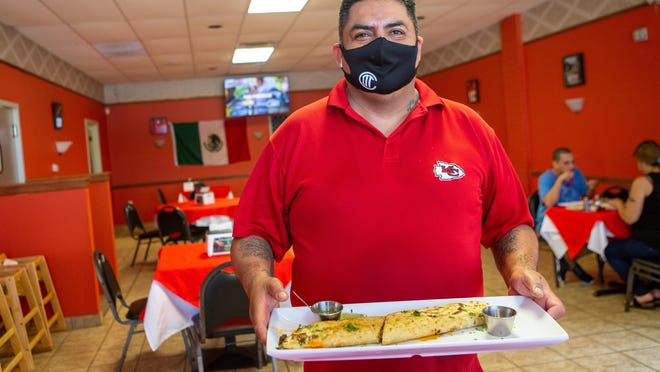 Alfredo Castillo, owner of Los Mandiles Rojos at 1003 S.E. Quincy St., presents The Machete, a long, oval corn tortilla grilled like a quesadilla with meat, cheese and vegetable filling.