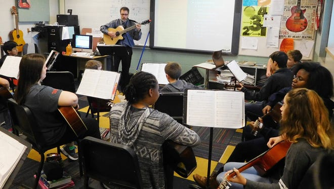 Josh Lessard leads his advanced guitar students in a sight-reading exercise.