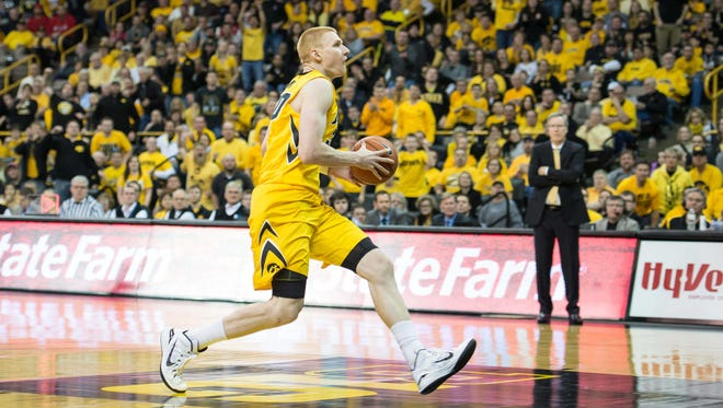Iowa forward Aaron White drives to the basket against Ohio State during the second half. Iowa won 76-67, marking White's first win over the Buckeyes at Carver-Hawkeye Arena.