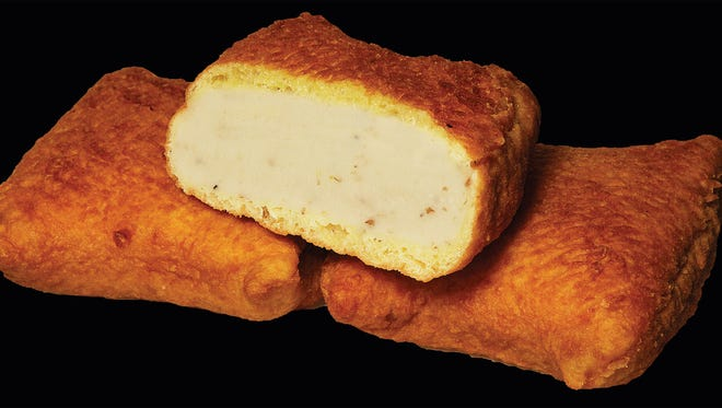 In this undated file photo provided by Gabila Food Products, Inc., three of their original Coney Island square knishes are shown. Five months after a fire closed the plant, Gabila's Food Products plant was given the go-ahead to reopen. There has been a nation-wide shortage of knishes since the September 24, 2013 fire.   (AP Photo/Gabila Food Products, Inc., File)