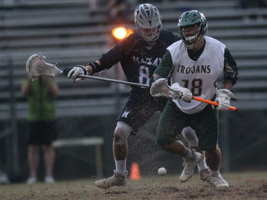 Lincoln's Evan Taylor and Maclay's Eli Paddack fight