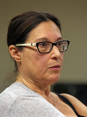 Activist Mona Freitag listens during a board meeting of the the Hartsdale Fire commissioners at Hartsdale Fire Station on Sept. 12, 2016.