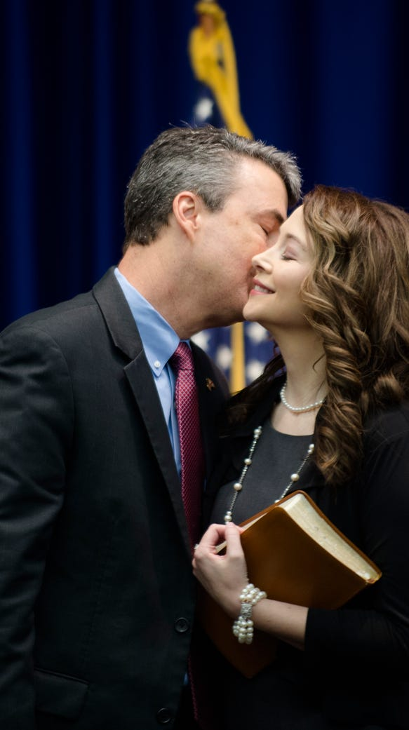 Steve Marshall kisses his wife, Bridgette Marshall,