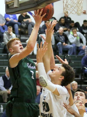 Shenendehowa's Kevin Huerter puts up a shot over Rice Memorial's Alex Bond in a National Division semifinal Tuesday at the Josh Palmer Fund Tournament.