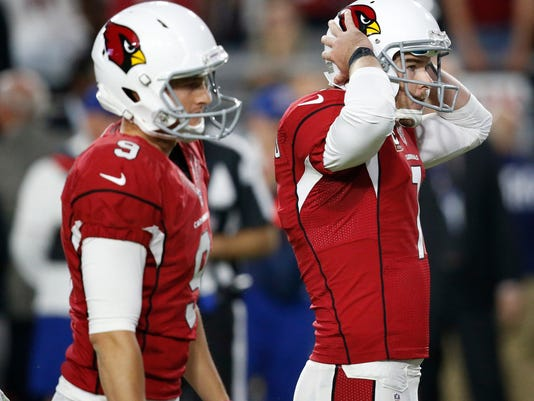Arizona Cardinals kicker Chandler Catanzaro (7) reacts to missing a game-winning field goal as punter Ryan Quigley (9) looks on attempt during overtime of an NFL football game against the Seattle Seahawks, Sunday, Oct. 23, 2016, in Glendale, Ariz. The game ended in overtime in a 6-6 tie. (AP Photo/Ross D. Franklin)
