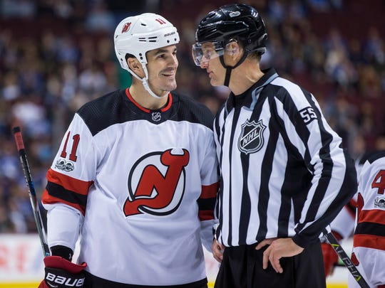 New Jersey Devils' Brian Boyle talks with linesman Shane Heyer during the first period of an NHL hockey game against the Vancouver Canucks, Wednesday, Nov. 1, 2017 in Vancouver, British Columbia.   (Darryl Dyck/The Canadian Press via AP)