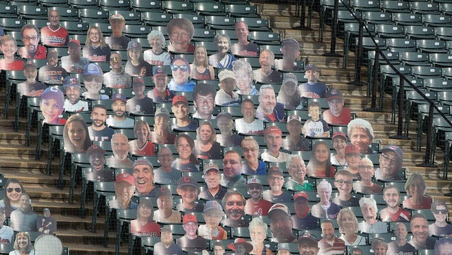 """A cutout of Beacon Journal columnist Bob Dyer is on the far right in the top row in Section 138 at Progressive Field. He is wearing an Omar Vizquel jersey that he got when he and Vizquel teamed up to write the shortstop's autobiography, """"Omar,"""" which spent four weeks on the New York Times bestseller list in 2002."""
