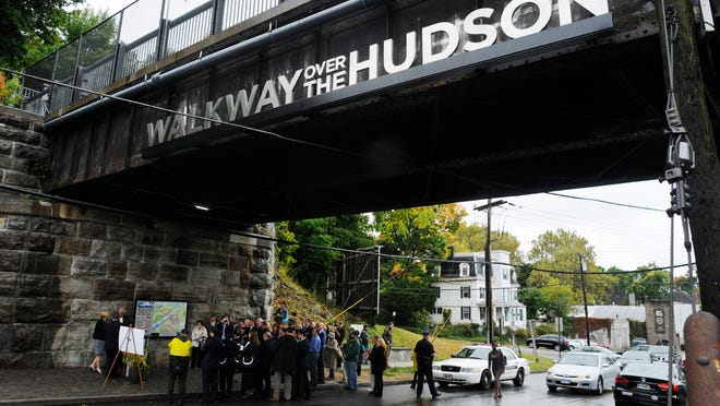 Walkway Over the Hudson officials were joined by New York Secretary of State Cesar A. Perales and other city, county, and state officials for the unveiling of the Washington Street entrance to the Walkway in the City of Poughkeepsie on Wednesday.