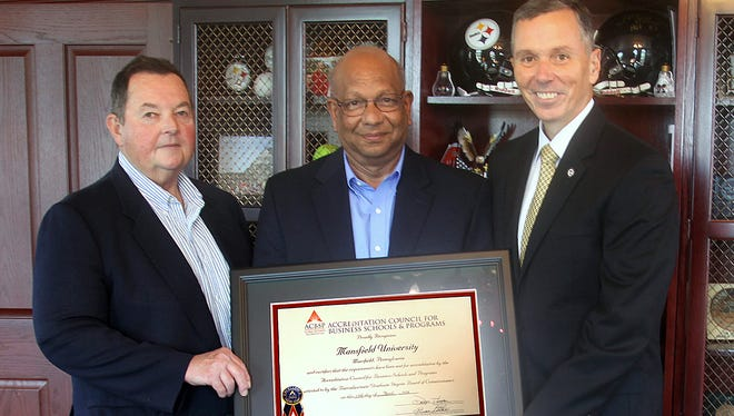 From left, Mansfield University assistant professor of business Andy Havalchak, department Chairman Gopalan Kutty and university President Fran Hendricks show off a certificate of certification for the department.