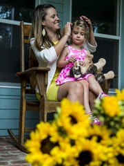 Emily Neustrom plays with her niece Ceci Carner, 3, at their family's home in Lafayette, La., Friday, June 5, 2015.