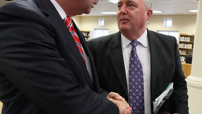 State Representative House Minority Leader Rocky Adkins, left, shakes hands with Tome Shelton, Executive Director of the Kentucky Association of School Superintendents, Monday, at Woodford County High School, after releasing more details of a shared responsibility plan for helping fund the state pension for teachers.November 6, 2017