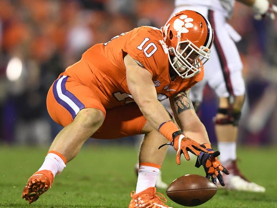 Clemson linebacker Ben Boulware (10) attempts to scoop up a fumble against South Carolina on Nov. 26, 2016, at Clemson's Memorial Stadium.