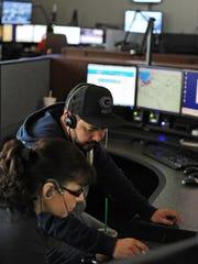 Dispatchers Sergio Ramirez and Lisa Perez work out