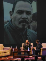 Actor Emilio Rivera, left, chats with host Rick Najera during the Latino Thought Makers forum at Oxnard College on Wednesday evening.