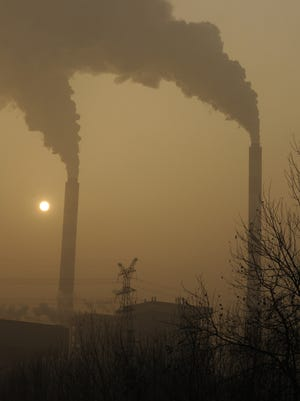 Smoke belches from a coal-powered power plant on the outskirts of Linfen, in China's Shanxi province in this 2009 photo.