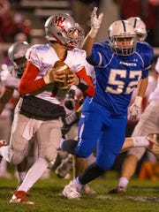 West LafayetteÕs  Mikey Kidwell rolls out against defenders