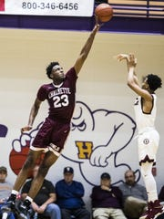 Western Kentucky commit and Chalmette (La.) High School center Mitchell Robinson (left) blocks a shot against Ballard during the Wes Strader Schoolboy Classic at Bowling Green High School.