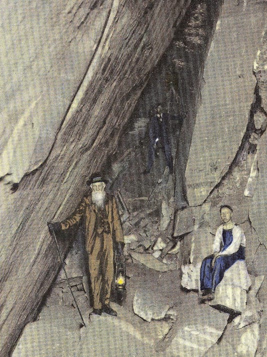 JM Flack in Rumbling Bald Cave, from postcard
