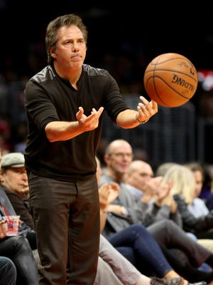 Detroit Pistons owner Tom Gores tosses the ball to a referee during a game against the Los Angeles Clippers at Staples Center on Monday, Dec. 15, 2014, in Los Angeles.