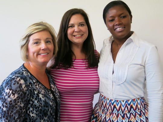 Ro White, Meghan Hochstetler, Dr. Felice Williams at the Most Influential Woman Award.