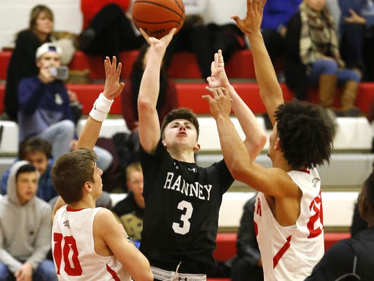 Alex Klatsky (3) of Ranney School, shoots over Point