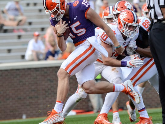 Clemson quarterback Hunter Johnson (15) runs in for a touchdown during the the spring game in Memorial Stadium in Clemson on Saturday, April 14, 2018.