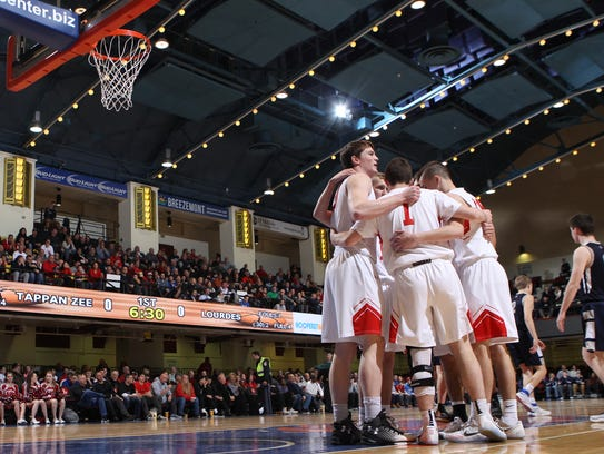 The Tappan Zee boys are pictured huddling during last year's Section 1 Class A championship game against Our Lady of Lourdes at the County Center. The arena seats over 4,000 spectators — nearly double Pace's capacity of 2,400.