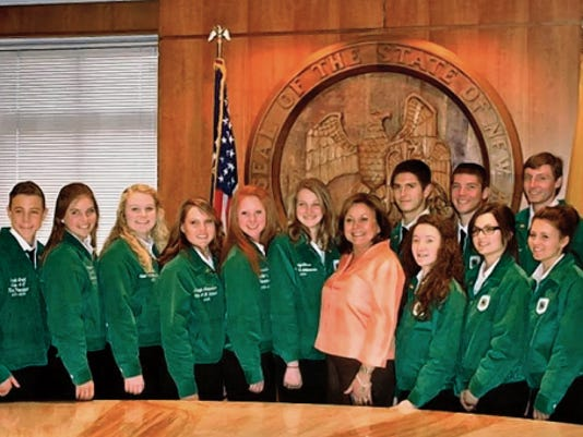 A group of former New Mexico 4-H state leaders meet with Governor Susana Martinez.