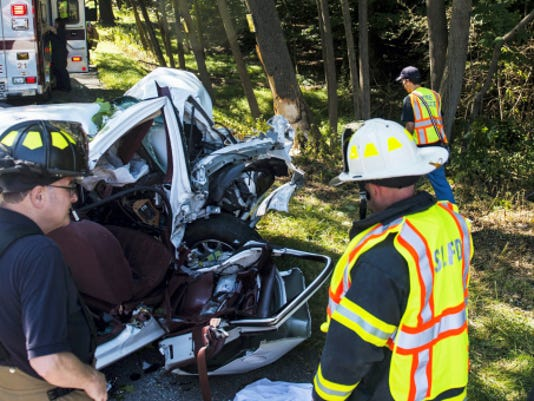 Emergency crews check the wreckage at the scene of a fatal crash on Route 322 in South Lebanon Township near Walnut Springs Road on Tuesday.