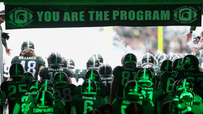 Michigan State Spartans take the field for action against the Purdue Boilermakers on Saturday, October 3, 2015 at Spartan Stadium in East Lansing Michigan.