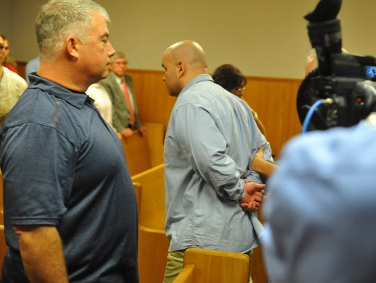 Adam Sanchez Jr. is led out of the courtroom at the