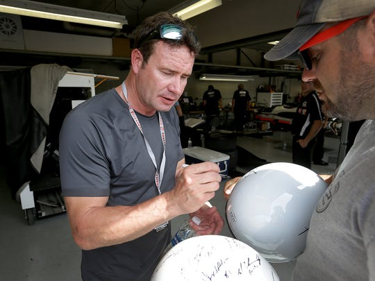 IndyCar driver Buddy Lazier signs autographs for fans out front of his garage during practice for the Indianapolis 500 Wednesday, May 17, 2017, afternoon at the Indianapolis Motor Speedway.