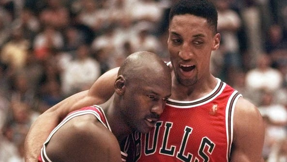 The Chicago Bulls' Michael Jordan collapses in the